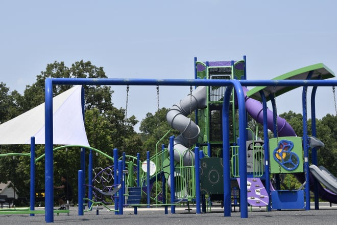 Shots were fired Friday evening at the Crestmont Park playground, injuring two adults.