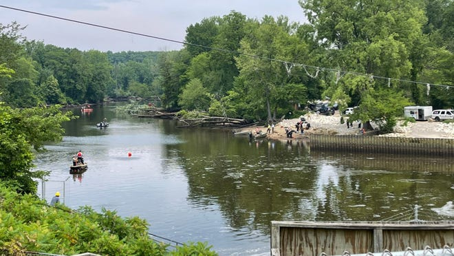 Emergency crews search for a diver who did not resurface Wednesday, July 7, near the Calkins Bridge Dam in Allegan. Consumers Energy says the diver worked for one of its contractors, Great Lakes Engineering Group, and was inspecting the dam.