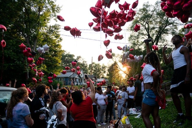 Friends and family of Michael Anthony Charles Johnson release balloons to honor him at a vigil in Peoria on Tuesday, July 6, 2021.