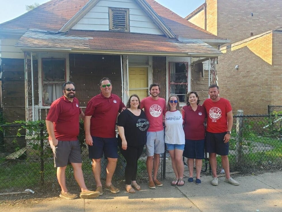 Members of charity group Build Peoria stand in front of the location of their next project which is to be a new park on Peoria's south side. Members from left to right, Kyle Lewis, Nick Yates, Andrea Huprich, Pete Chambers, Jaymee Barra, Darlene Violet, Dirk Madison.