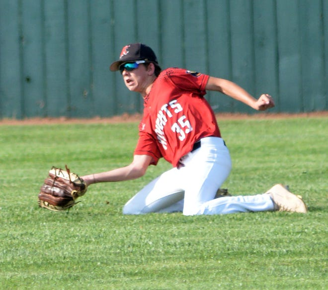 Newton Junior Knight Owen Myers snags a fly ball to set up a double play during play Tuesday against Hutchinson. Newton won the first game 9-1 and lost the second game 12-9.