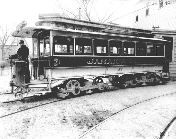 This open-end car and engineer pose in front of the Forest Hills carhouse (which would later become the Jamaica Loop) about 1896. By 1905, all cars were enclosed. To learn a lot more, visit the Jamaica Plain Historical at www.jphs.org.