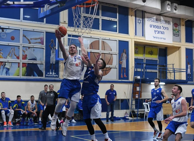 Shown is Grant Greenberg attempting a layup for Maccabi Carmiel in the Israel-Artzit league during the 2020-21 season. Greenberg was a regular starter and averaged 25 points, 9.7 rebounds, 3.3 assists and two steals a game while shooting over 50% from the field.