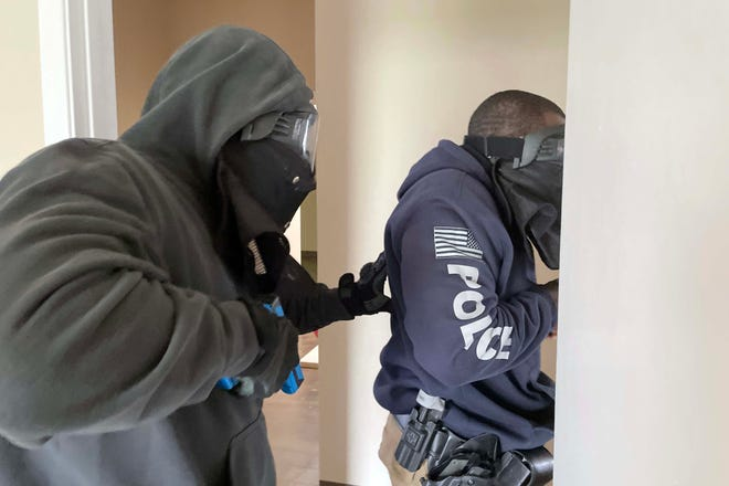 Fort Walton Beach Police Department officers conduct active shooter training Wednesday at a vacant commercial building on Beal Parkway.