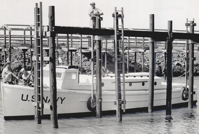 A 38-foot U.S. Naval picket boat gets readied by sailor reservists, becoming the first surface craft to float on the waters of Lake Hefner in July 1947. The lake was built to become a water supply for Oklahoma City and was named after Robert A. Hefner, who was the city's mayor from April 1939 to April 1947. The boat didn't get far, since it had to stay docked until the public opening of the lake.