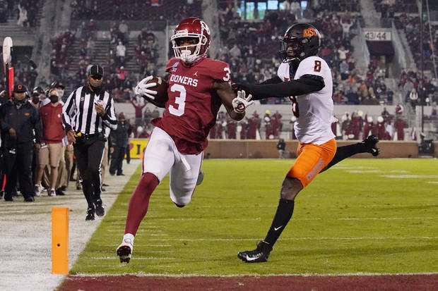 Oklahoma's Mikey Henderson runs for a touchdown in Norman last November during a 41-13 victory over Oklahoma State.
