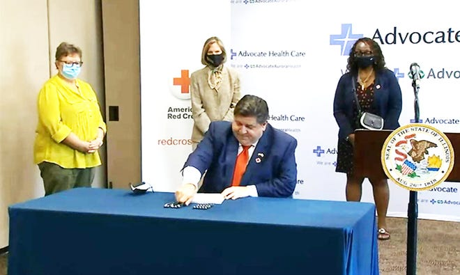Gov. JB Pritzker signs a bill into law expanding coverage under the state's Medicaid plan for mental health, substance abuse treatment and a number of other services.