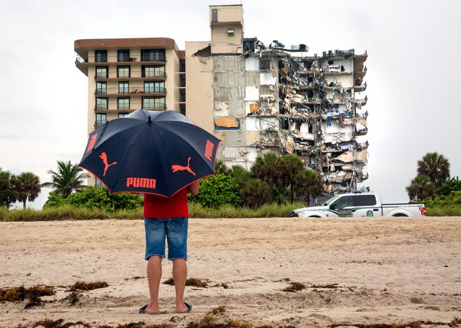 The remnants of the Champlain Towers South condominium in Surfside stand after the June 24 collapse of part of the building. The remaining part of the building was later demolished.