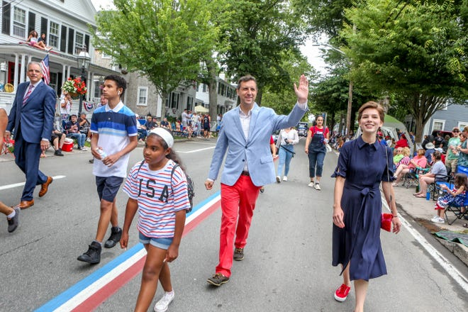 Journal staff writer Amy Russo, right, walks in the Bristol Fourth of July parade with state General Treasurer Seth Magaziner, center, a Bristol native who has participated in the parade since he was 18 years old. Rhode Island Attorney General Peter Neronha is at left.