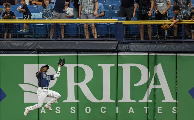 Tampa Bay right fielder Vidal Brujan makes a leaping catch on a fly ball hit by Cleveland's Harold Ramirez during the seventh inning in the second game of a doubleheader Wednesday, July 7, 2021, in St. Petersburg, Fla.(AP Photo/Steve Nesius)