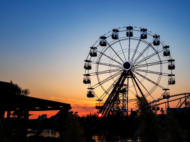 A Ferris wheel at sunset.