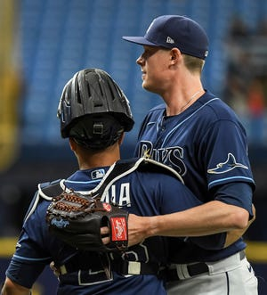Tampa Bay reliever Pete Fairbanks and catcher Francisco Mejia celebrate a 4-0 win over Cleveland in the second game of a doubleheader Wednesday, July 7, 2021, in St. Petersburg, Fla. The Rays held Cleveland without a hit in the seven-inning game. (AP Photo/Steve Nesius)