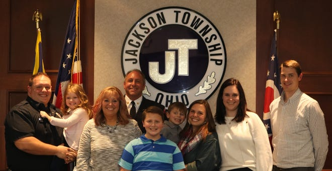 Jackson Township Fire Department Chief Timothy Berczik's family joined him for the swearing in ceremony during a Jackson Township Trustee's meeting on March 9. From left, Jason (son), Maddie (granddaughter), Chris (spouse), Chief Berzcik, Caleb (grandson), Ben (grandson), Stephanie (daughter), Brittany (daughter-in-law) and Dustin (son-in-law).