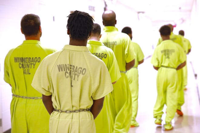 Rockford and Winnebago County agreed to split the cost of an $800,000 prisoner re-entry program that would target some of the region's most violent returning offenders for a program that both promises swift punishment for those who reoffend but also offers a helping hand. In this 2019 file photo, inmates at the Winnebago County Jail are being transported to court.