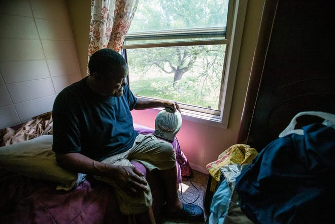 Henry Renolds talks last week about electricity problems in his unit at the Westcott Apartments. Renolds had to run an extension cord from the living room to his bedroom for electricity.