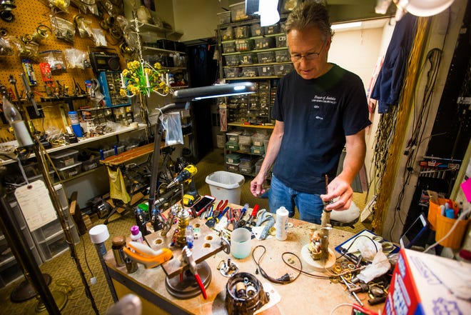 Custom repair specialist Kirk Hall talks about his workspace at the House of Andala Lamp Shoppe in South Bend. Hall estimates he completes 80 to 100 repairs a month.