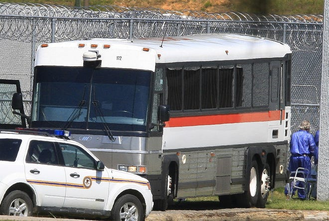 Prisoners are unloaded at Butner Federal Correctional Complex in Butner, North Carolina, on July 14, 2009. Disgraced financier Bernard Madoff has been moved out of a New York lockup to this North Carolina facility.