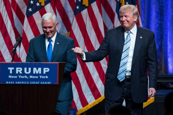 Republican presidential candidate Donald Trump, right, introduces Gov. Mike Pence, R-Ind., during a campaign event to announce Pence as the vice presidential running mate on July 16, 2016, in New York.