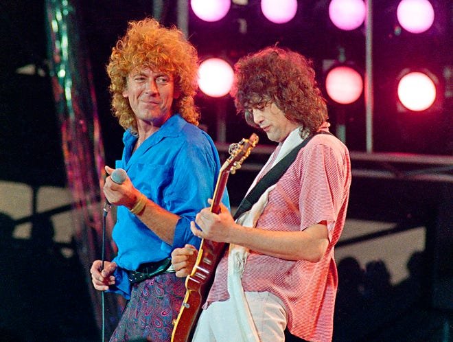 In this July 13, 1985 photo, Led Zeppelin bandmates, singer Robert Plant, left, and guitarist Jimmy Page, reunite to perform for the Live Aid famine relief concert at JFK Stadium in Philadelphia.