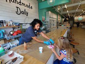 Kristin Reed  with Buff City Soap helps customer Kimber Schubert design her handmade soap.