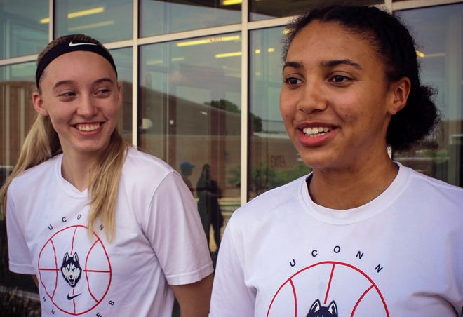 UConn basketball players Paige Bueckers, left, and Azzi Fudd, right, speak to the media outside the the school's Werth basketball practice facility Tuesday in Storrs.