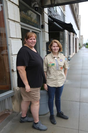 Camryn Clark, Boy Scout with Troop 7, and her mother Jennifer Clark stand in front Juli's Cafe in late June. For Clark's Eagle Scout project, she created a U.S. flag reclamation box located at Washburn Rural high school.