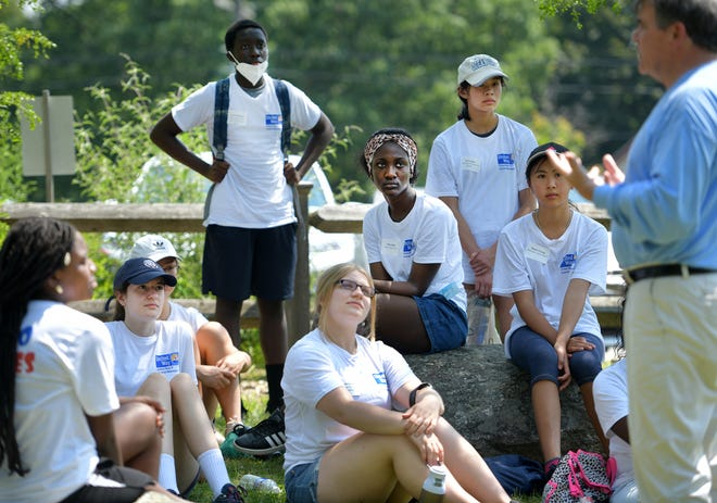 President of United Way Tim Garvin speaks to students at Mass Audubon's Broad Meadow Brook Wednesday. WooServes is a six-week youth development program created by the United Way of Central Massachusetts.