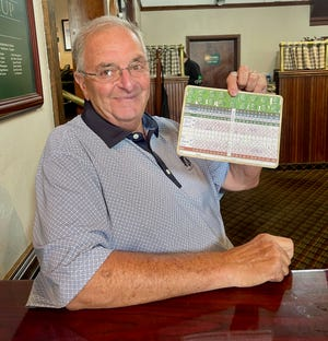 Leominster's Jim Ruschioni at Wachusett Country Club with his scorecard when he shot his age for the 100th time on Monday, July 5.