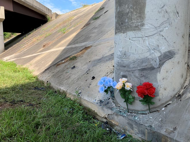 Flowers mark the scene of a fatal wreck Tuesday night under the Martin Luther King Jr. Freeway overpass on Southern Avenue.