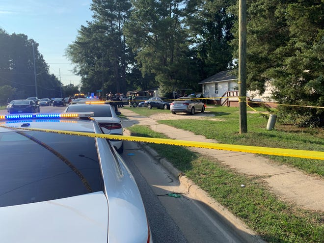 Police investigate the scene of a fatal shooting in the 1100 block of Bunce Road Tuesday evening.
