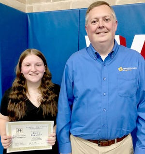 Emma Bergoon, a senior at West Holmes High School and resident of Killbuck, is the eighth recipient of Rea & Associates' annual Marcia Stutzman Memorial Scholarship. Pictured, from left: Bergoon and Tom Jeffries.