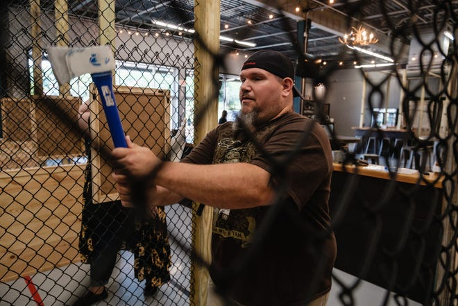 Leonard Pittman, a Monroe County resident, lines up his throw during a session at the Hatchet Club in Sugarcreek. Pittman and his wife, Erin, were visiting during their 15th wedding anniversary celebration.
