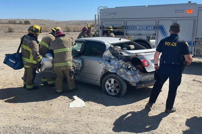Kern County firefighters free woman trapped briefly in wrecked car
