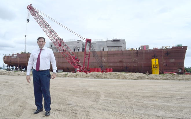 Sen. Marco Rubio stands in front of the first of four U.S Coast Guard Offshore Patrol Cutters being built by Eastern Shipbuilding.