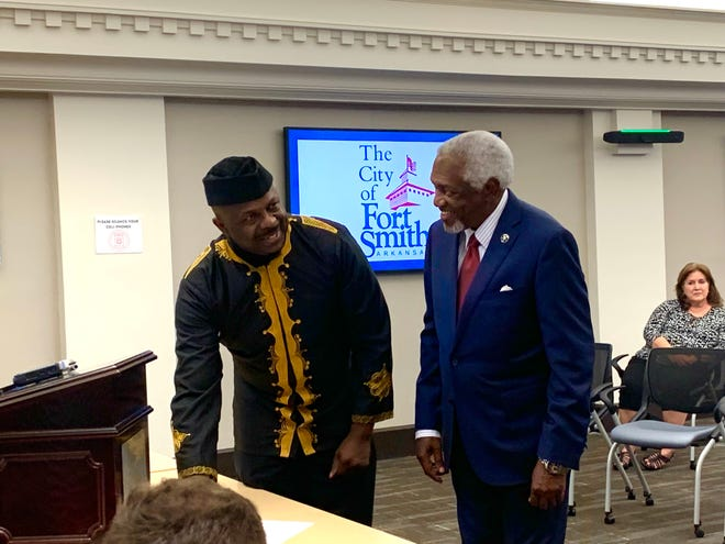 United Nations Ambassador of Art Ibiyinka Alao stands alongside Mayor George McGill as they sign the declaration recognizing Fort Smith as a city for artistic and cultural innovation in peace building and economic growth. Fort Smith is the 10th city to receive the designation.