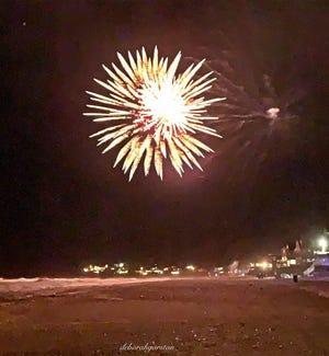 Fireworks illuminate White Horse Beach on the Fourth of July.