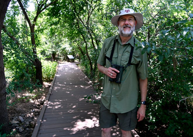 Biologist Rick Hammer on the boardwalk at the Kirby Lake Nature Park.