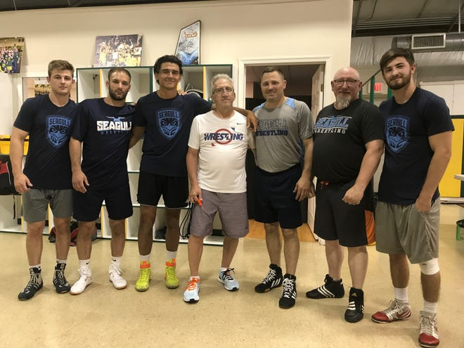 Seagull Wrestling Club's coaching staff consists of (left to right) Trace Kinner, Toby Hague, John Van Brill, Pete DiBiase, Brandon Becker, Jack Campbell and Quinn Kinner.