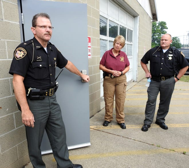 Sheriff Jim Crawford with Det. Nancy Wilt and Capt. Garrison Bryant at the McCoy Building where the department holds lost property and evidence from cases. Wilt was recently named the full-time property and evidence technician and renovations were done to the building including a new secure entry door.