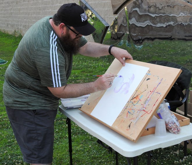 Nate Lovett does a watercolor character sketch at the artPARK as he taught 11 teens how to do their own works as part of a summer program through the Flight School of Coshocton Behavioral Health Choices.