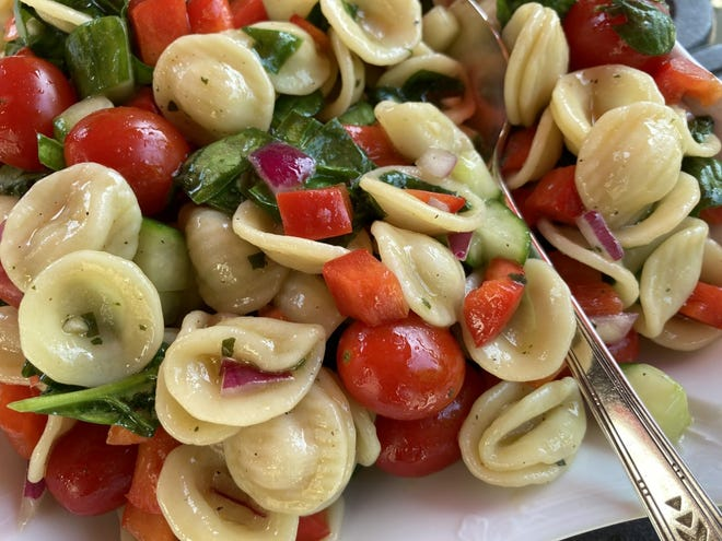 Farmers Market Pasta Salad contains tomatoes, peppers and cucumbers.