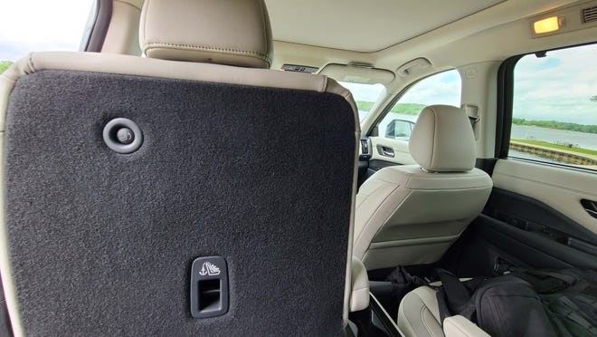 From the third-row seat of the 2022 Nissan Pathfinder, passengers can exit using a single button.
