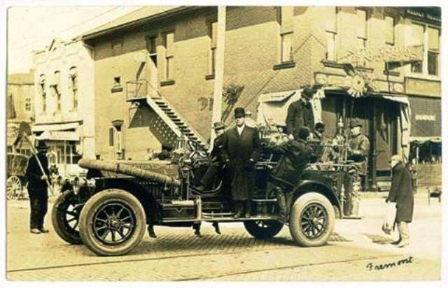 This early fire vehicle is parked on Croghan Street, Fremont, in 1915.