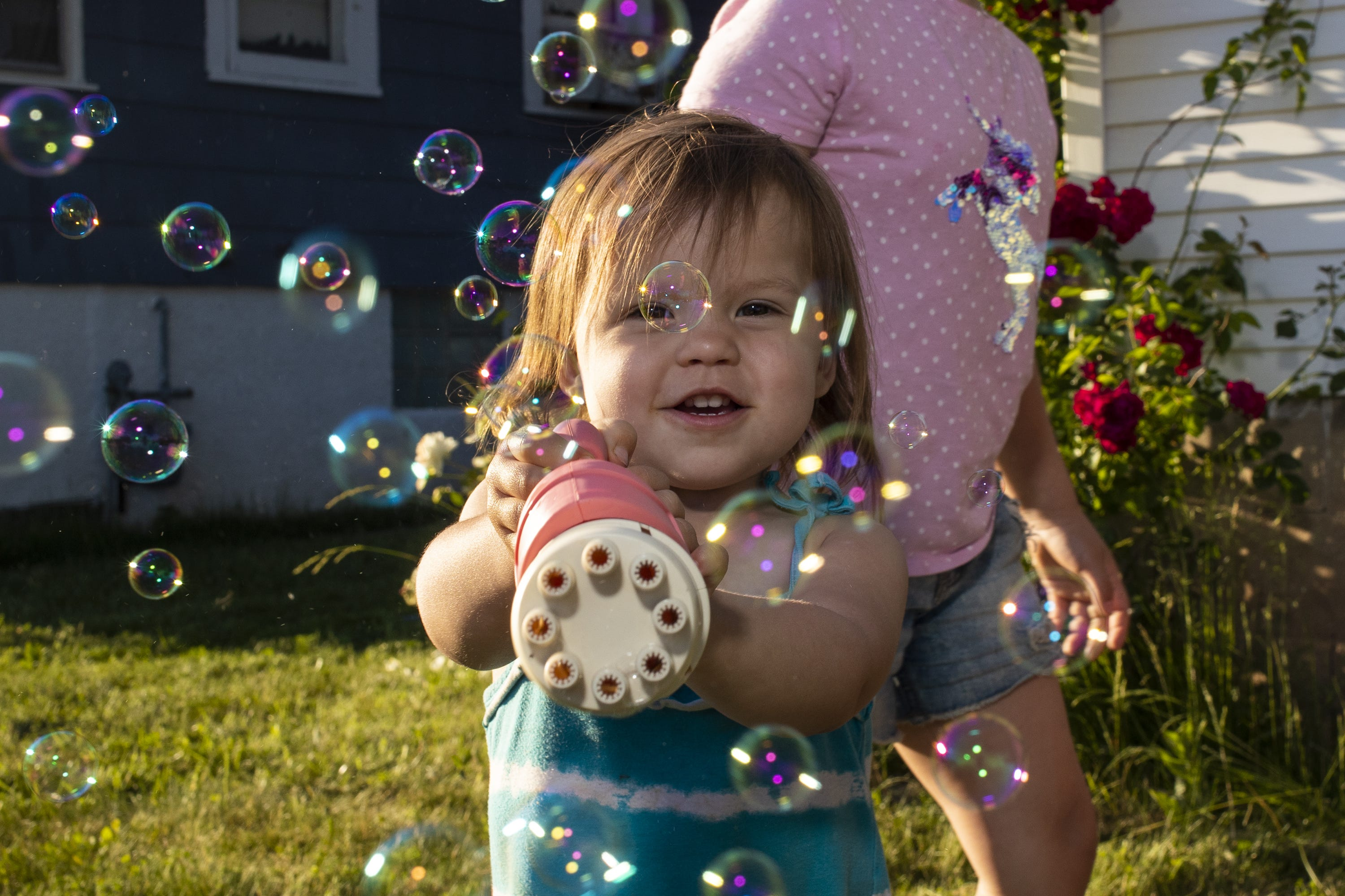Jaleesa Gray's daughter plays with bubbles outside her home, Tuesday, June 15, 2021, Green Bay, Wis. Samantha Madar/USA TODAY NETWORK-Wisconsin