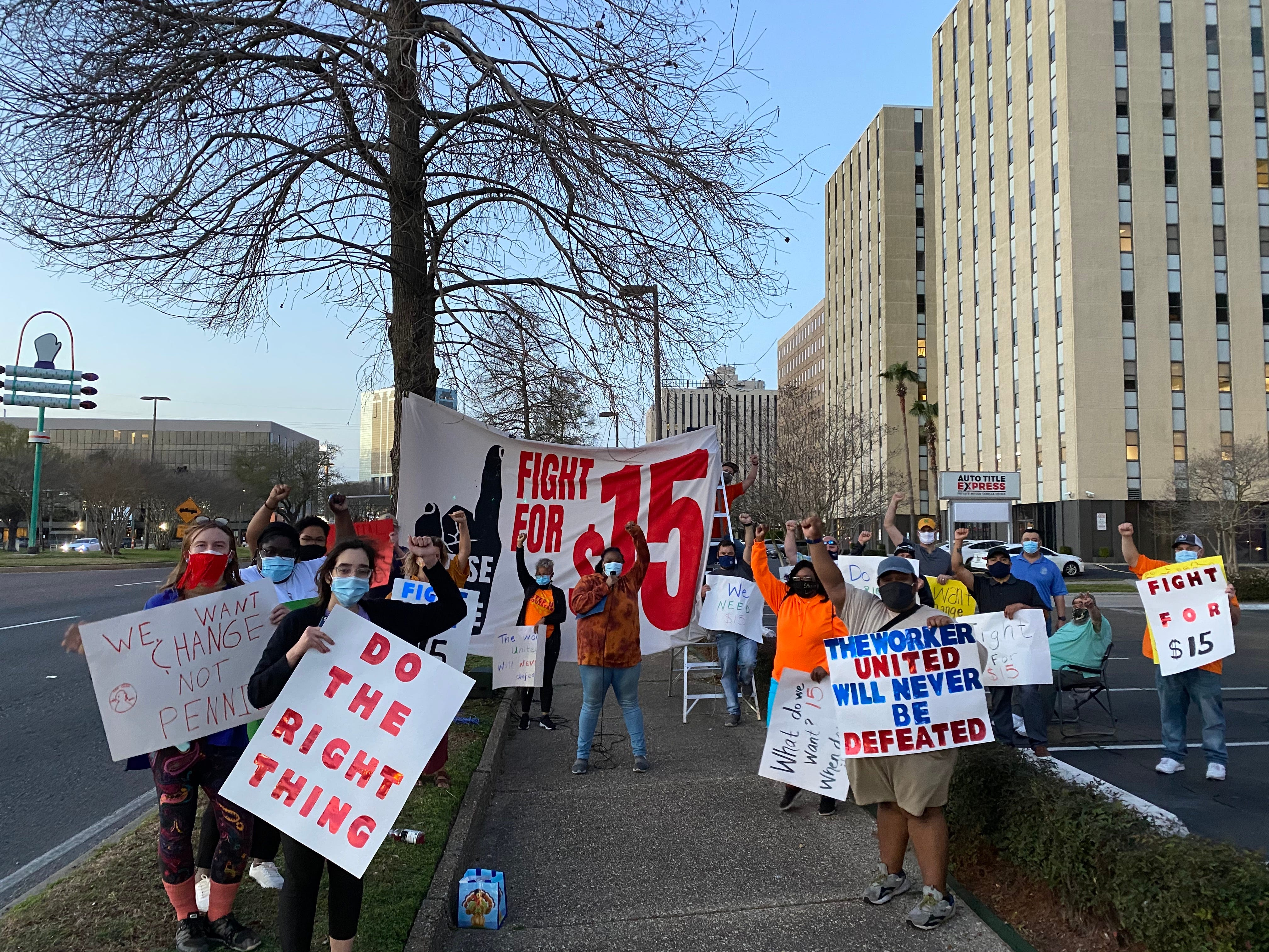 Step Up Louisiana members protest for a $15 minimum wage outside of Sen. Bill Cassidy's office in Metairie, LA in March 2021.