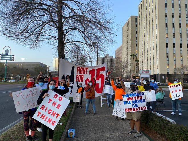 Protesters call for a $15 minimum wage outside a senator's office in Metairie, Louisiana, in March 2021.