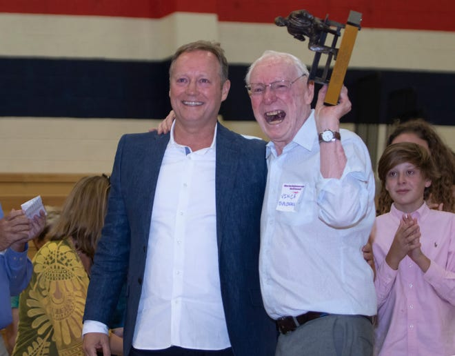 Mike Budenholzer and his dad, Vince, celebrate at the Budenholzer Court dedication at Holbrook High School in Holbrook, Arizona. Budenholzer Court is named for Vince, Mike and the entire Budenholzer family and was dedicated in July 2019. Mike is head coach of the Milwaukee Bucks.