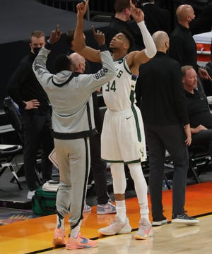 Milwaukee Bucks forward Giannis Antetokounmpo (34) and Milwaukee Bucks forward Thanasis Antetokounmpo (43) get ready before the game of the NBA Finals game 1 between the Milwaukee Bucks and the Phoenix Suns at the Phoenix Suns Arena in Phoenix on Tuesday, July 6, 2021.