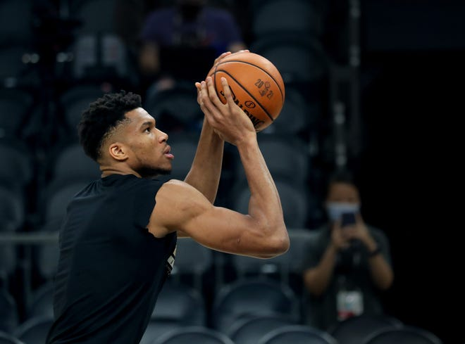Milwaukee Bucks forward Giannis Antetokounmpo shoots during a practice session at the Phoenix Suns Arena in Phoenix on Wednesday.