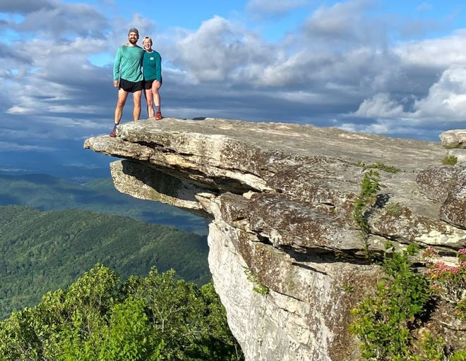 Kara and Nick Saur hang out on a cliff in southern Virginia.